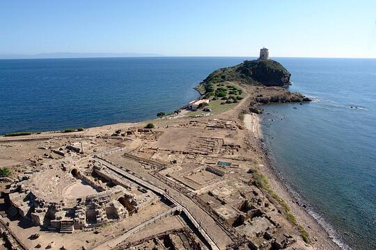 Aerial view of the eastern part of the peninsula of Nora. The Roman forum and the medieval tower of Coltellazzo are visible. Photo courtesy of Gianni Alvito, Teravista